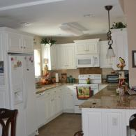 Charming, White Washed Kitchen Cabinets